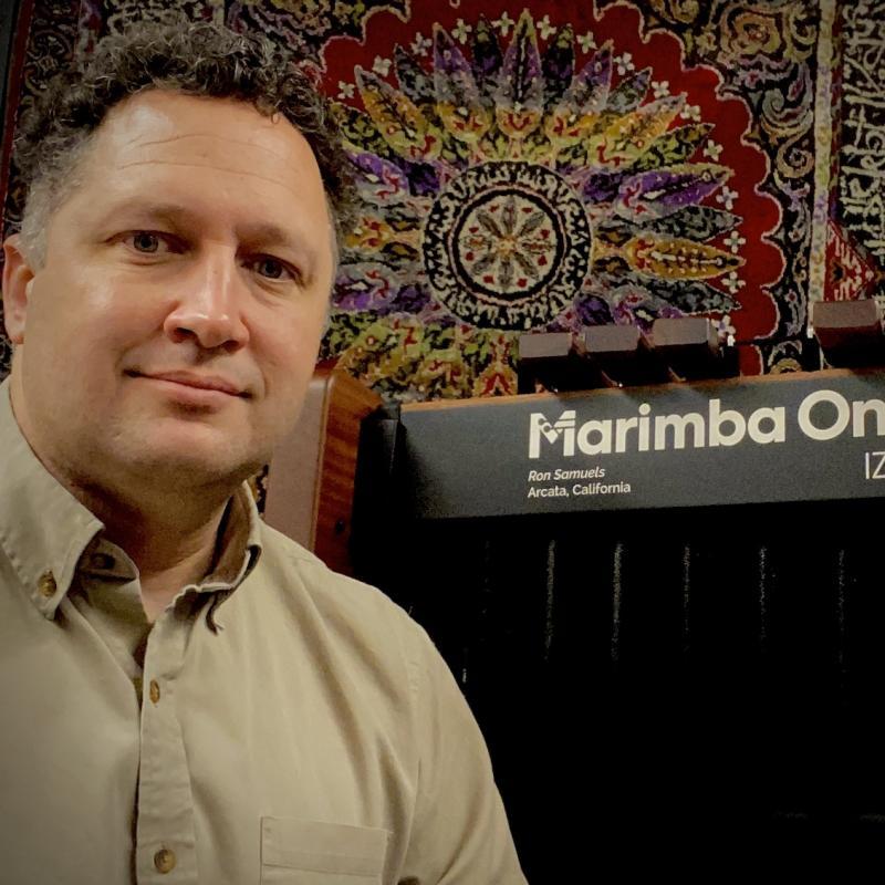 Dr. Stefan Ice next to a Marimba One marimba